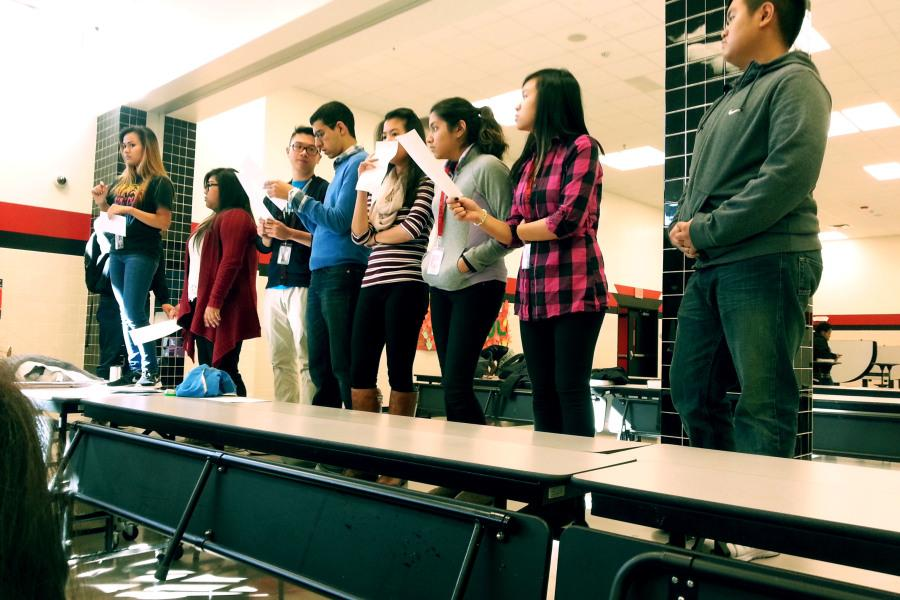 The Key Club officers stand ready to give out details of the schedule.
