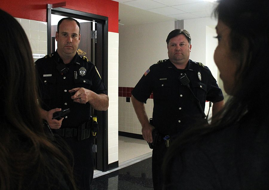 Officers Chris Mittendorf and Steve Schnoeblen speak to students during lunch. Both officers are new to North and have been making an effort to get to know their new Raider family.